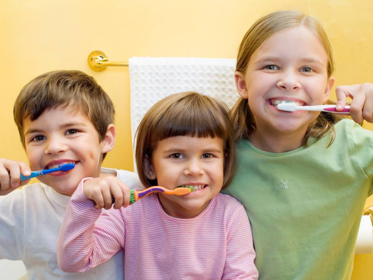 Kids brushing teeth